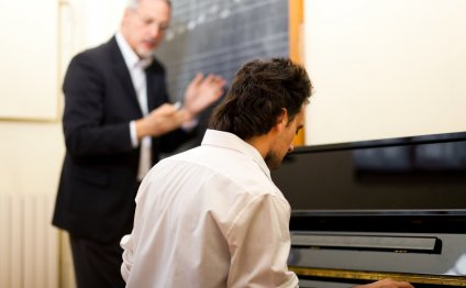 Instructor Giving Man Piano